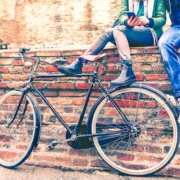 Couple and bike on a brick wall