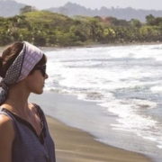 Woman on beach considering a health challenge